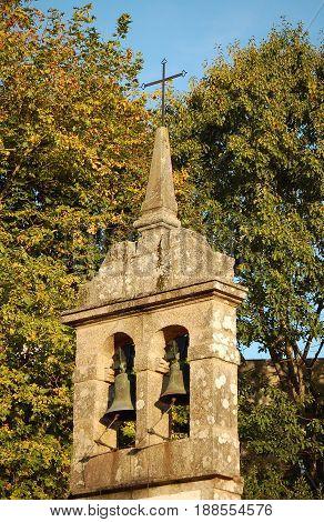 Cross and bells of the little chapel in Parque da Música en Compostela - Santiago de Compostela Galicia Spain
