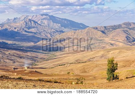 Ploughed fields and the Sicani Mountains between Agrigento and Palermo - Sicily Italy
