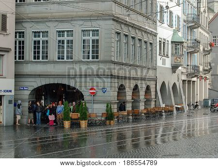 People find shelter under an arcade in Limmaquai during a sudden downpour of rain - Zurich Switzerland, 21 July 2008