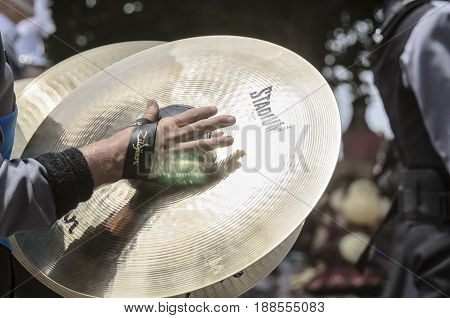 Bristol Rhode Island USA - July 4 2011: Sunlight glints off ridges on marching band cymbals