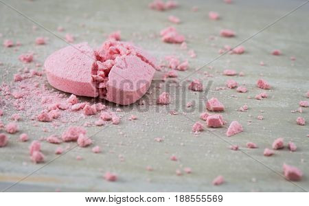 Broken Candy Heart with Crushed Candy Bits Strewn Around Wide