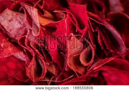 Bunched Edges of Red Fabric in close up shot