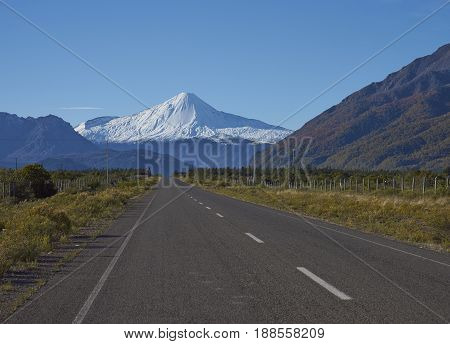 Snow capped peak of Antuco Volcano (2,979 metres) rising above the road to Laguna de Laja National Park in the Bio Bio region of Chile.