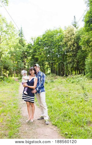 Mixed race family walking on a rural path.