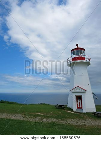 gaspesie lighthouse at cape gaspe, quebec canada