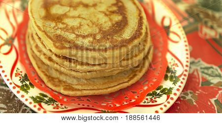 Plate of traditional fresh homemade hot pancakes for christmas breakfast