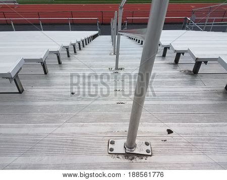 metal sports seating and stairs and running track