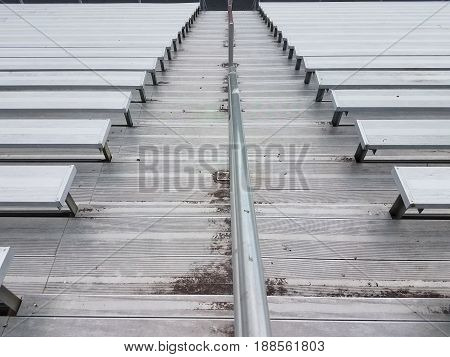 metal sports seating and stairs and railing