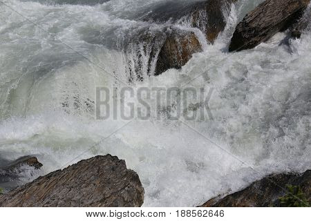 natural white water, river rocks in a national park, canada