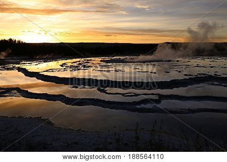 Great Fountain Geyser at Sunset, in Yellowstone National Park, WY, USA