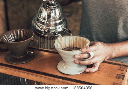Drip Coffee. Hot Arabica Coffee Brew Hand Making Process By Professional Vintage Color With Grain No