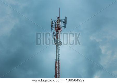 dark cloudy strom communication tower high power wifi antenna post hotspot long range digital data transport