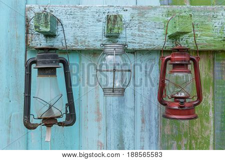Western Style Oil Lantern Hanging At Farm Countryside, Old Lamp Vintage Style Hang On Wood Backgroun