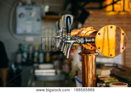 Closeup Bar Beer Pipe Tap In Modern Pub And Restuarant.