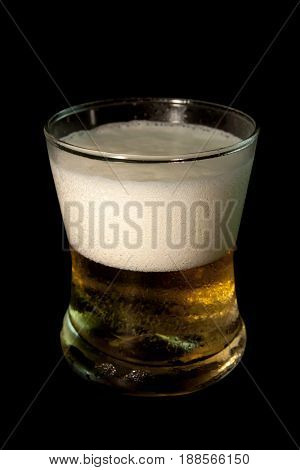 Beer in glass isolated on black background. Pour beer. objects with clipping paths.