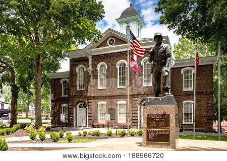 Loudon Tennessee USA - May 25 2017: War Memorial in front of the Loudon County Courthouse which was built in 1872 and is still in use today.