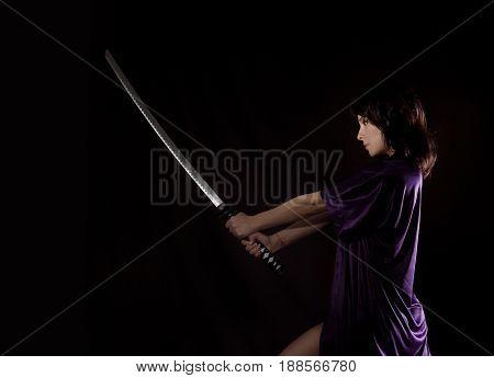 beautiful sexy woman with samurai sword. sexy woman with katana.