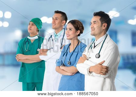 Doctors Group, Surgeon And Nurse On Hospital Background