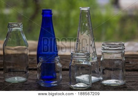 Empty Jars And Bottles On The Wooden Window Sill