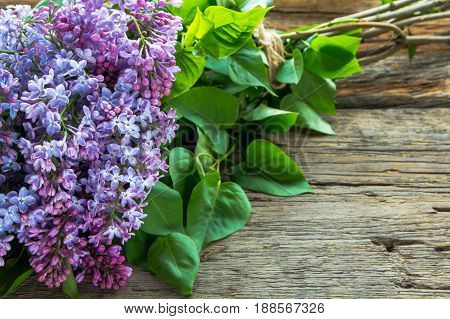 Lilac Flowers Bouquet On The Old Wooden Background.