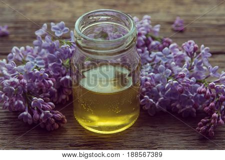 Organic Honey In Glass Jar Surrounded By Spring Blossom Purple Lilac