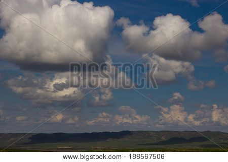 Steppe in spring Kazakhstan. Amazing clouds and sky.
