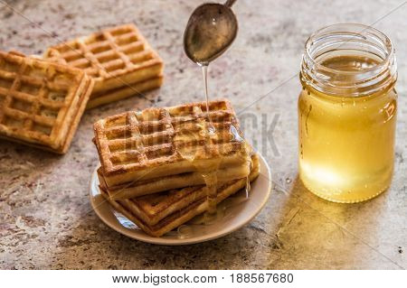 Baked Waffles And Organic Sweet Honey For Breakfast