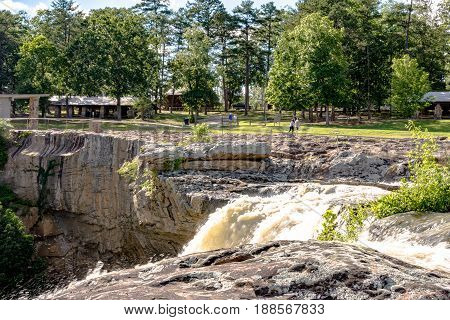 Gadsden Alabama USA - May 25 2017: A view from the top of Noccalula Falls after a storm system passed through earlier in the week. The water drops 90 feet into the Black Creek ravine below.
