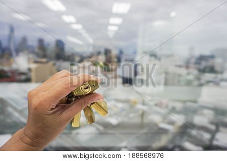 business concept - people hold lock for key of success