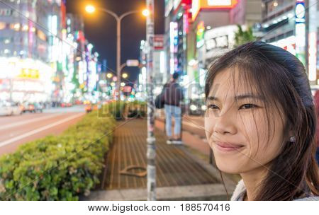 Female Tourist are traveling in Shinjuku Shopping district.