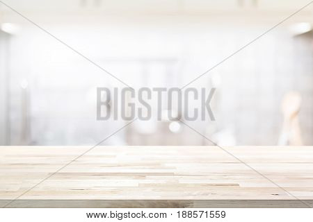 Wood countertop (or kitchen island) on blur kitchen interior background - can be used for display or montage your products (foods)
