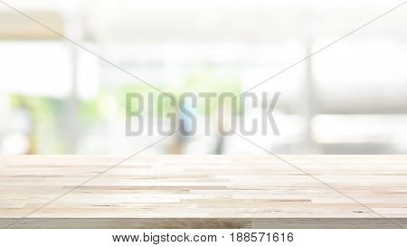 Wood table top on white blur abstract background from outdoor covered walkway in the city - can be used for display or montage your products 16:9 proportion size
