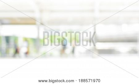 Blur image of covered walkway with people in the city - abstract background 16:9 proportion size