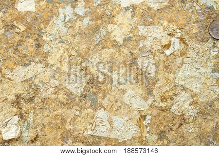 Gold leaf on the wall background in thailand.