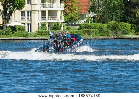 BERLIN GERMANY - MAY 03 2014: Trip to visitors on a powerful motorboat. 2nd Berlin water sports festival in Gruenau