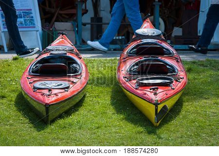 BERLIN GERMANY - MAY 03 2014: Sport boats kayaks and canoes at the marina. 2nd Berlin watersports festival in Gruenau on the river Dahme tributary of the river Spree