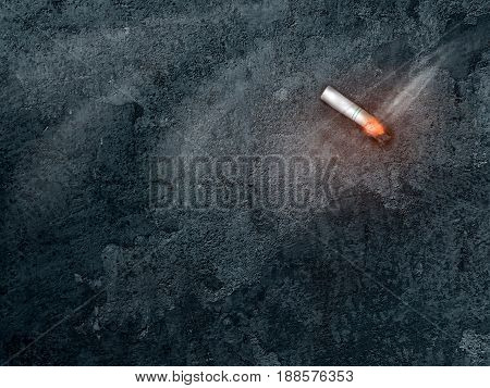 burning cigarette on dark background with copy space. world no tobacco day on may 31