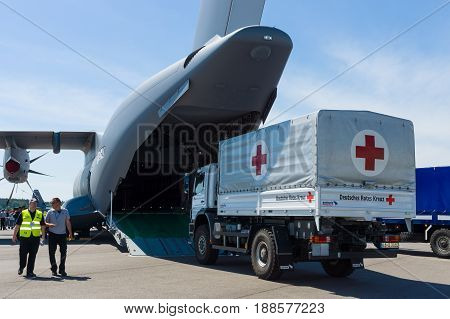 BERLIN GERMANY - MAY 21 2014: Shipment of humanitarian aid of the German Red Cross in military transport aircraft of the French Air Force Airbus A400M Atlas. Exhibition ILA Berlin Air Show 2014