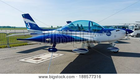 BERLIN GERMANY - MAY 21 2014: Italian Ultralight aircraft and Light-sport aircraft Fly Synthesis Texan Top Class 600. Wefly Team. Exhibition ILA Berlin Air Show 2014