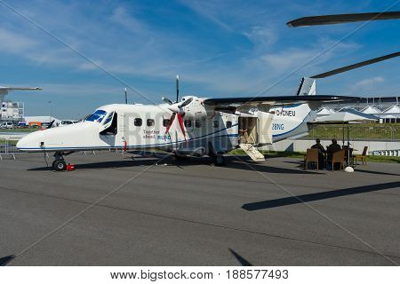 BERLIN GERMANY - MAY 21 2014: A twin-turboprop STOL utility aircraft Dornier 228 New Generation. RUAG Aerospace Services GmbH. Exhibition ILA Berlin Air Show 2014