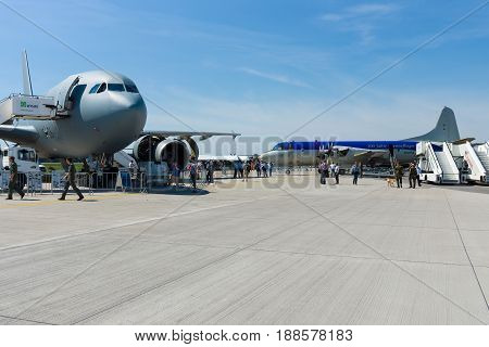 BERLIN GERMANY - MAY 21 2014: Lockheed Martin P3C Orion and Airbus A310 Multi Role Tanker Transport (MRTT) on the airfield. German Air Force. Exhibition ILA Berlin Air Show 2014