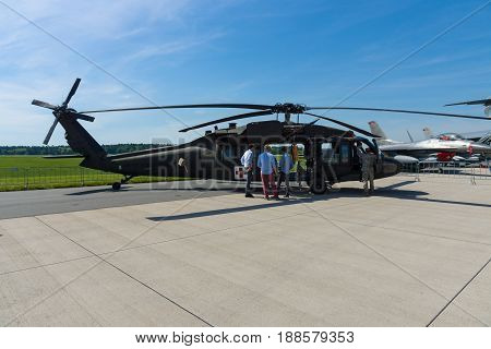 BERLIN GERMANY - MAY 21 2014: A four-bladed twin-engine medium-lift utility helicopter HH-60M Black Hawk (MEDEVAC). US Air Force. Exhibition ILA Berlin Air Show 2014