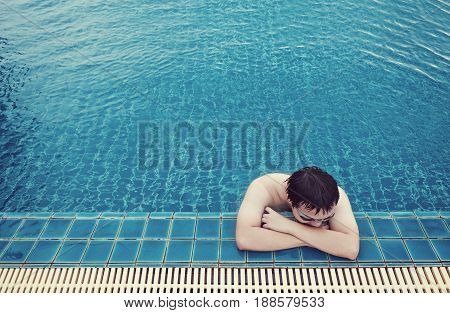 a guy relaxing in swimming in summer