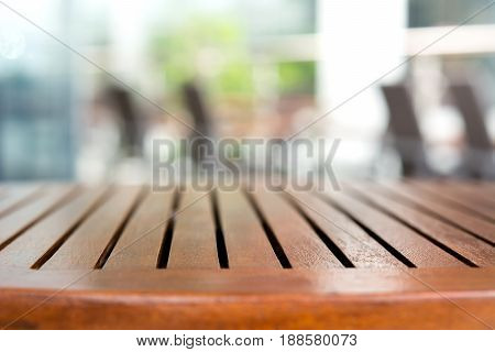 Empty round wood table top in outdoor cafe - can be used for mintage foods and products