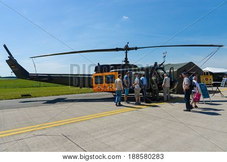 BERLIN GERMANY - MAY 21 2014: Military helicopter Bell UH-1 Iroquois. German Air Force as light utility as well as search and rescue (SAR) helicopters. Exhibition ILA Berlin Air Show 2014