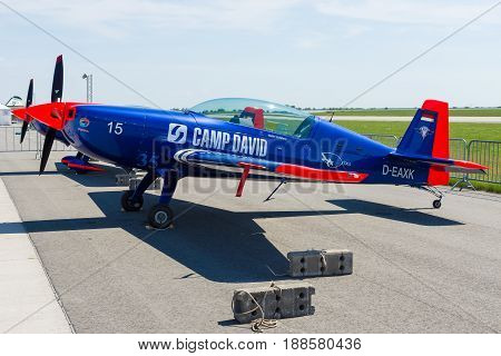 BERLIN GERMANY - MAY 21 2014: A two-seat aerobatic monoplane Extra Flugzeugbau EA300LT. Eichhorn Air Adventure Team. Exhibition ILA Berlin Air Show 2014