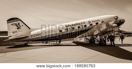 BERLIN GERMANY - MAY 21 2014: A fixed-wing propeller-driven airliner Douglas DC-3. Sepia. Exhibition ILA Berlin Air Show 2014
