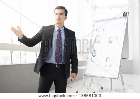 Young businessman as a meeting leader presenting his work
