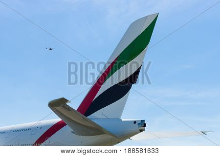 BERLIN GERMANY - MAY 21 2014: The empennage of a largest passenger airliner in the world Airbus A380. Emirates Airline. Exhibition ILA Berlin Air Show 2014