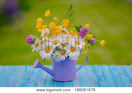 Bouquet Of Wild Flowers Of Different Colors In The Vase Outdoors